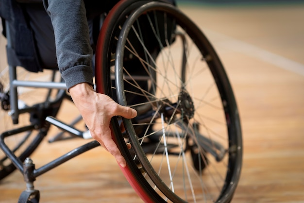 Close-up disabled man in basketball court