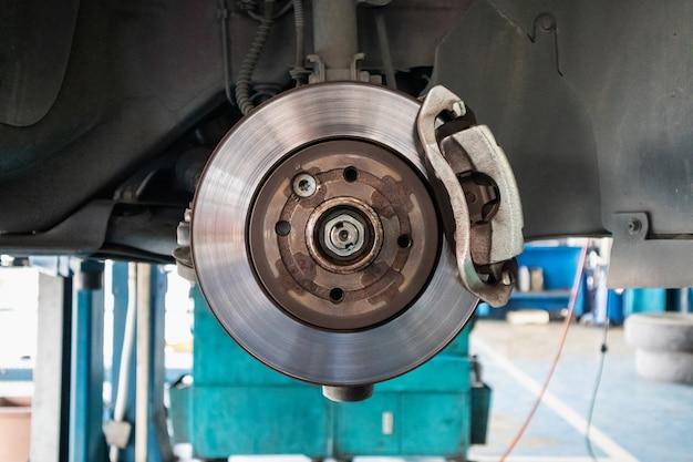 Close up disc brake at car service workshop
