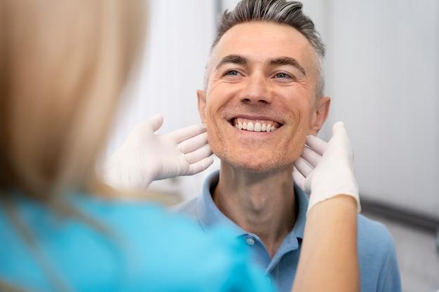 Close up doctor checking man
