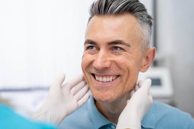 Close up doctor checking patient
