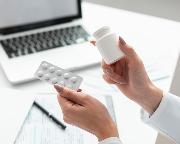 Close-up doctor holding medicine
