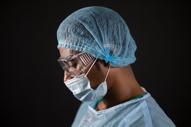 Close up doctor wearing mask and goggles
