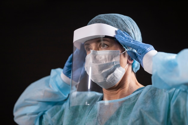 Close up doctor wearing protection equipment