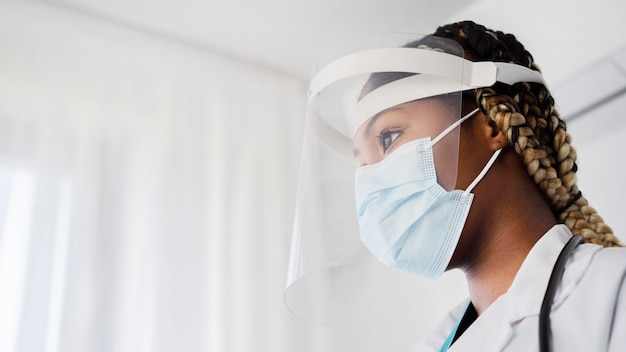 Close-up doctor wearing protective equipment