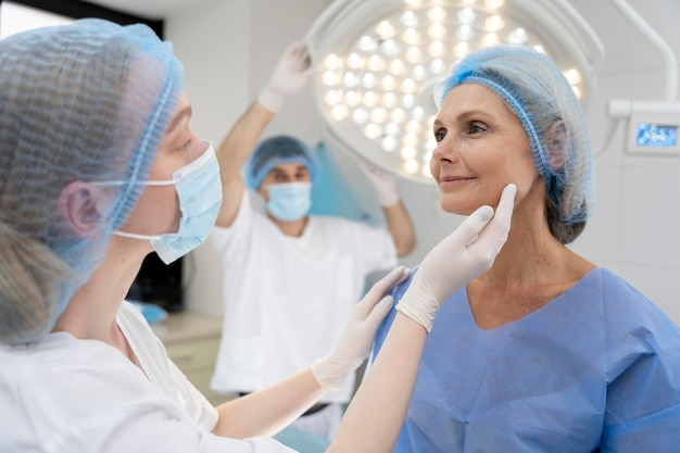 Close up doctor with mask checking patient