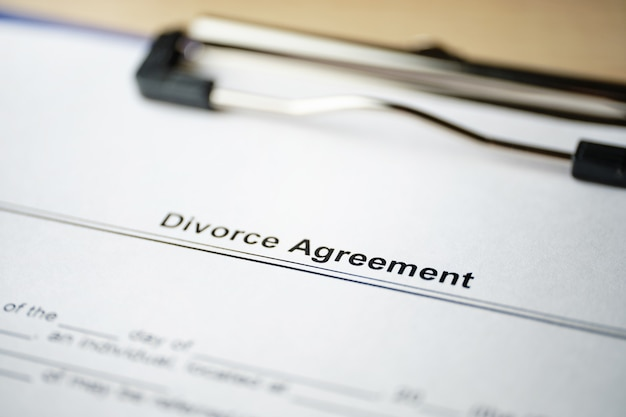 Close up on document of divorce agreement