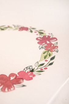 Close up of drawn flower frame with acrylic paint