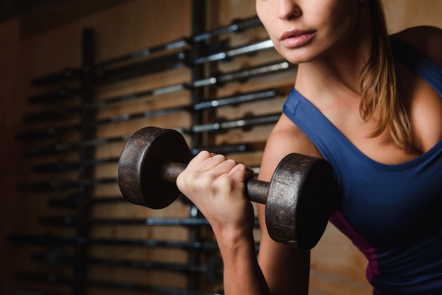 Close up of dumbbell in female hands