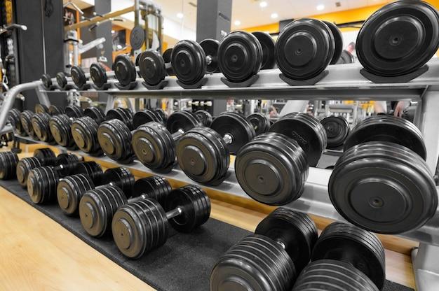 Close up of dumbbells gym interior