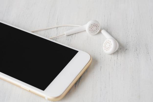Close-up of earphone on modern phone