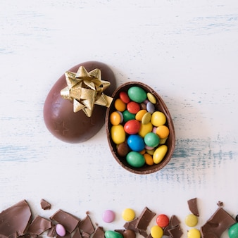 Close-up egg with candies and bow