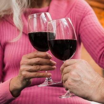 Close-up elderly couple toasting