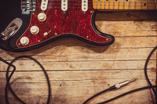Close-up of electric guitar lying on vintage wood