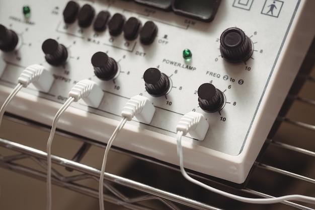 Close-up of electro stimulation device