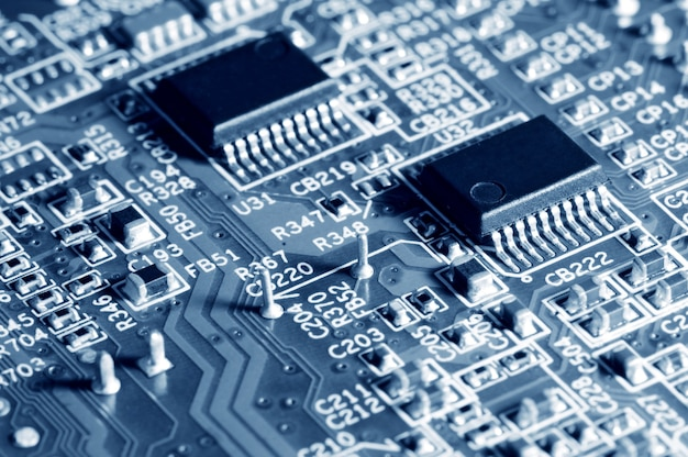 Close-up electronic circuit board with micro chips from a home appliance or laptop electronics and complex devices. concept of microchips and future technology