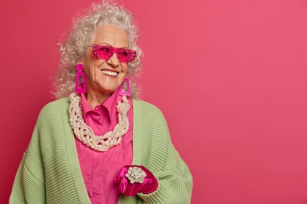 Close up on elegant elderly woman wearing stylish clothes isolated