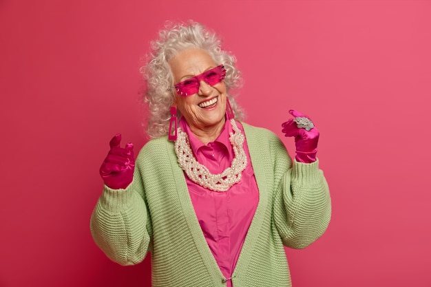 Close up on elegant elderly woman wearing stylish clothes isolated