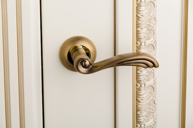 Close up an elegant golden door's handle