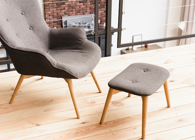 Close-up elegant modern armchair and stool