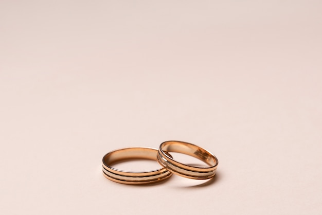 Close-up elegant wedding rings on the table
