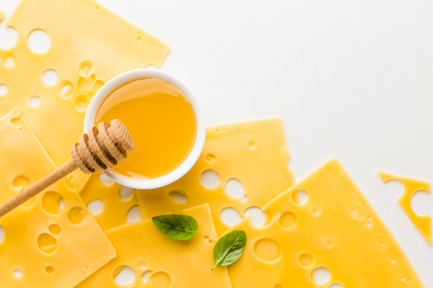 Close-up emmental cheese slices and honey