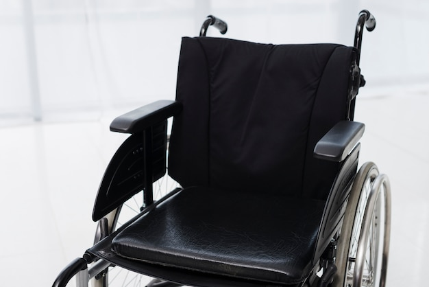 Close-up of an empty wheelchair in a room