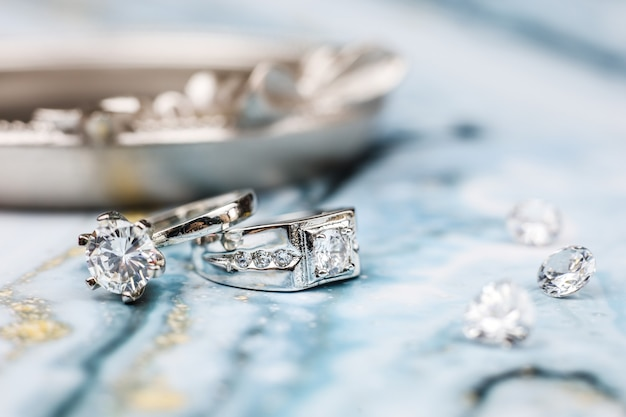Close up of engagement diamond ring love and wedding concept