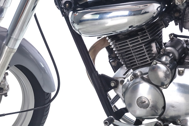 Close up of engine on vintage motorcycle on white background