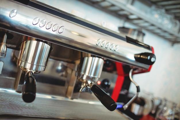 Close-up of espresso maker at coffee shop