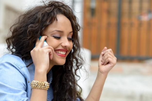 Close-up of excited woman talking on phone