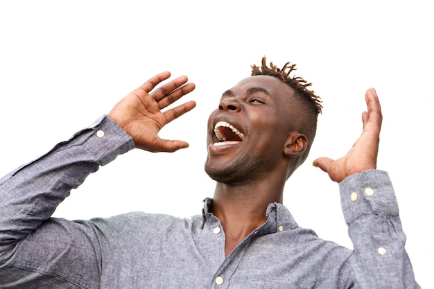 Close up excited young african man with surprised expression on white background