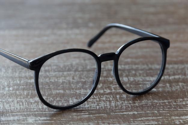Close up eye glasses on wood background