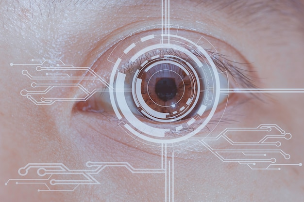 Close up of eye in process of scanning technology digital information.