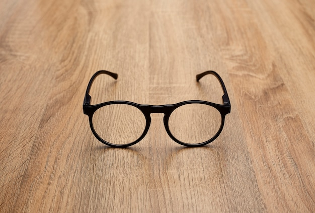 Close up of eyeglasses on table