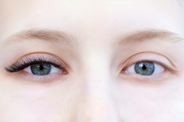 Close up on eyelash extension procedure