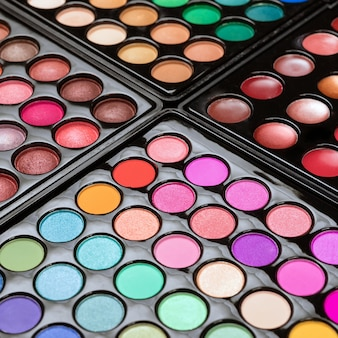 Close-up of eyshadow palettes as a space. make-up texture.