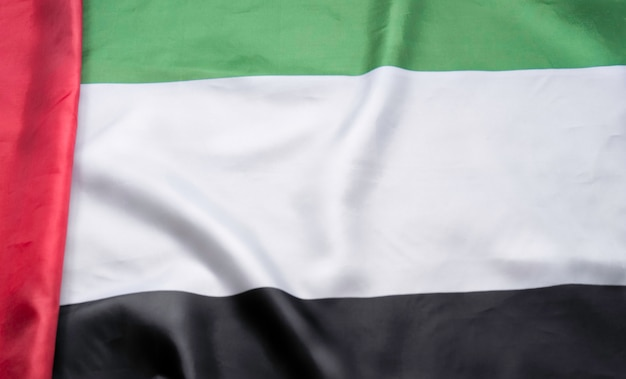 Close up of fabric texture of the flag of united arab emirates.