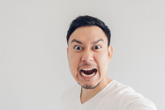 Close up face of angry man selfie himself.