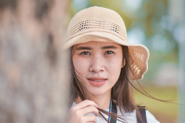 Close up face of asian beauty women with white hat at park outdoor