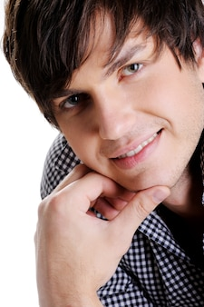 Close-up face of a cute sexy man posing in the studio. man with modern straight  hairstyle