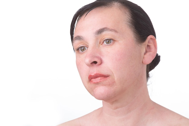 Close-up face of a mature woman without retouching. signs of skin aging after 40