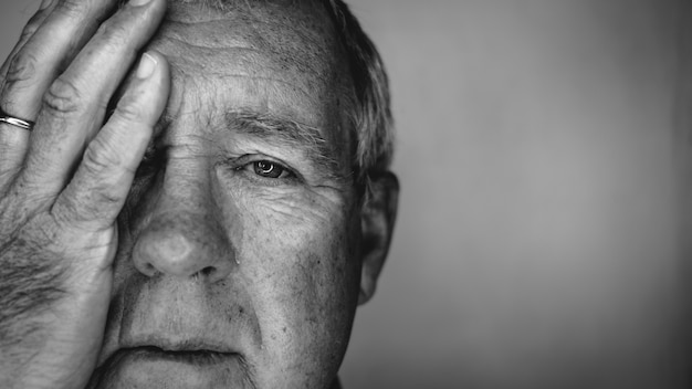 Close up face portrait older depressed man