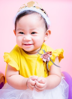 Close up face princess little baby girl in beautiful dress she is smile