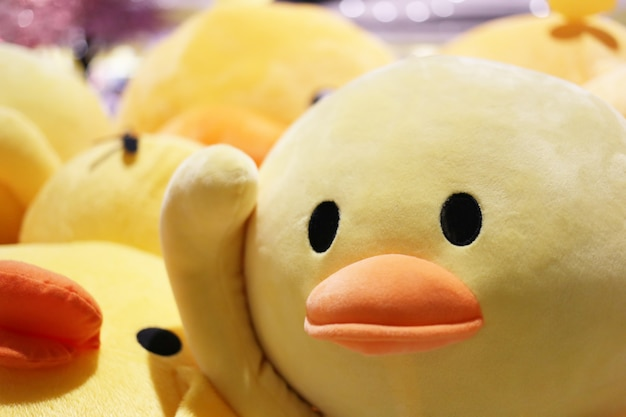 Close-up in face of yellow duck doll.