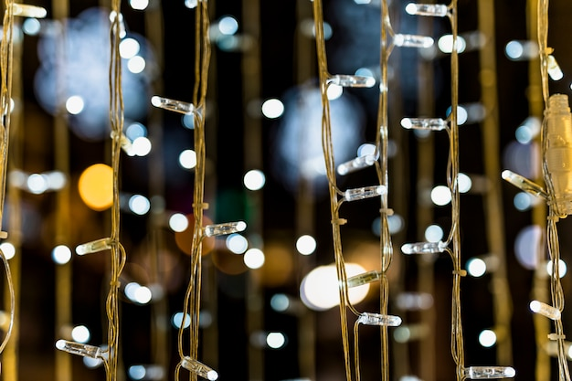 Close-up of fairy light against bokeh background