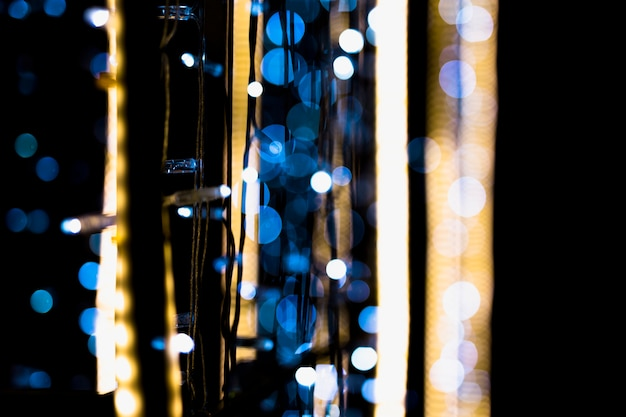 Close-up of fairy lights decoration with bokeh at night