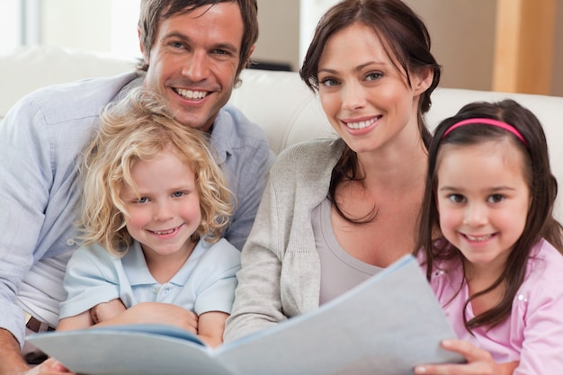 Close up of a family looking at a photo album