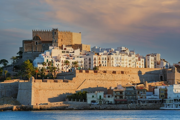 Close-up of the famous templar and medieval city of peniscola with its castle walls over the sea.