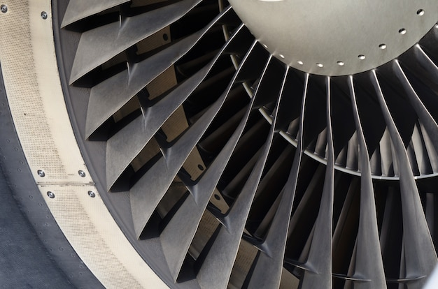 Close up fan blade of engine airplane.