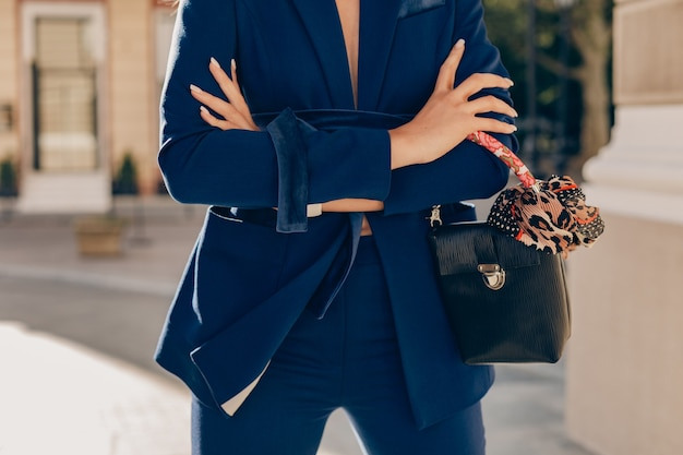 Close-up fashion details of elegant woman dressed in blue suit